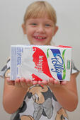 Girl holding box Tetrapak